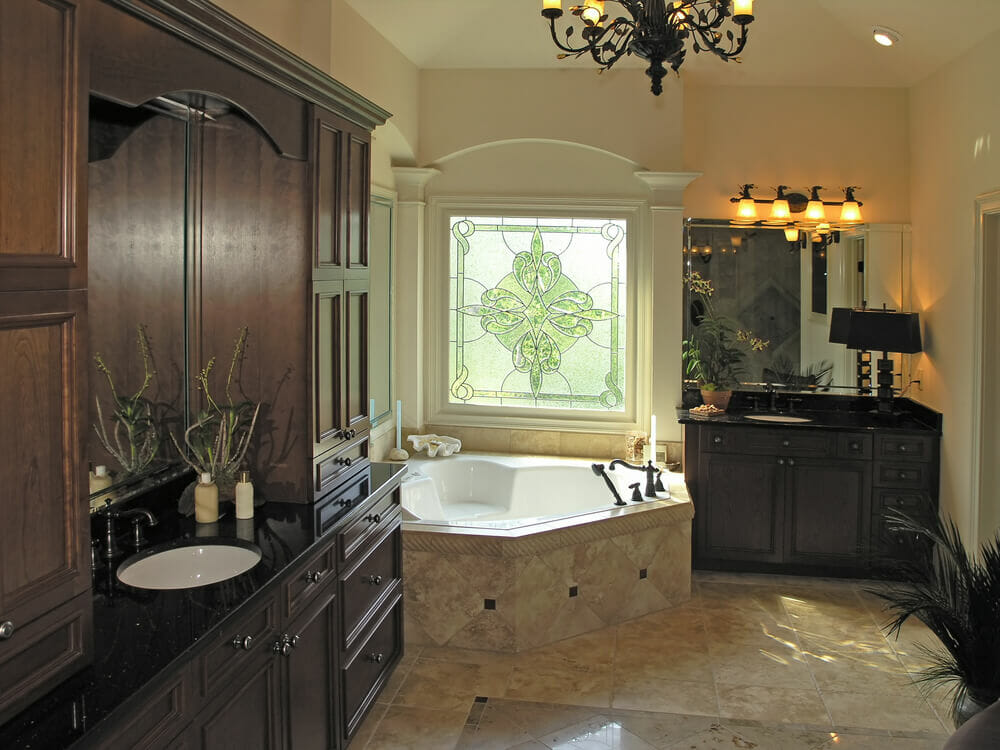 These Custom Bathrooms Are Designed With Beautiful Light Tile With Dark Wooden Cabinets That Create A