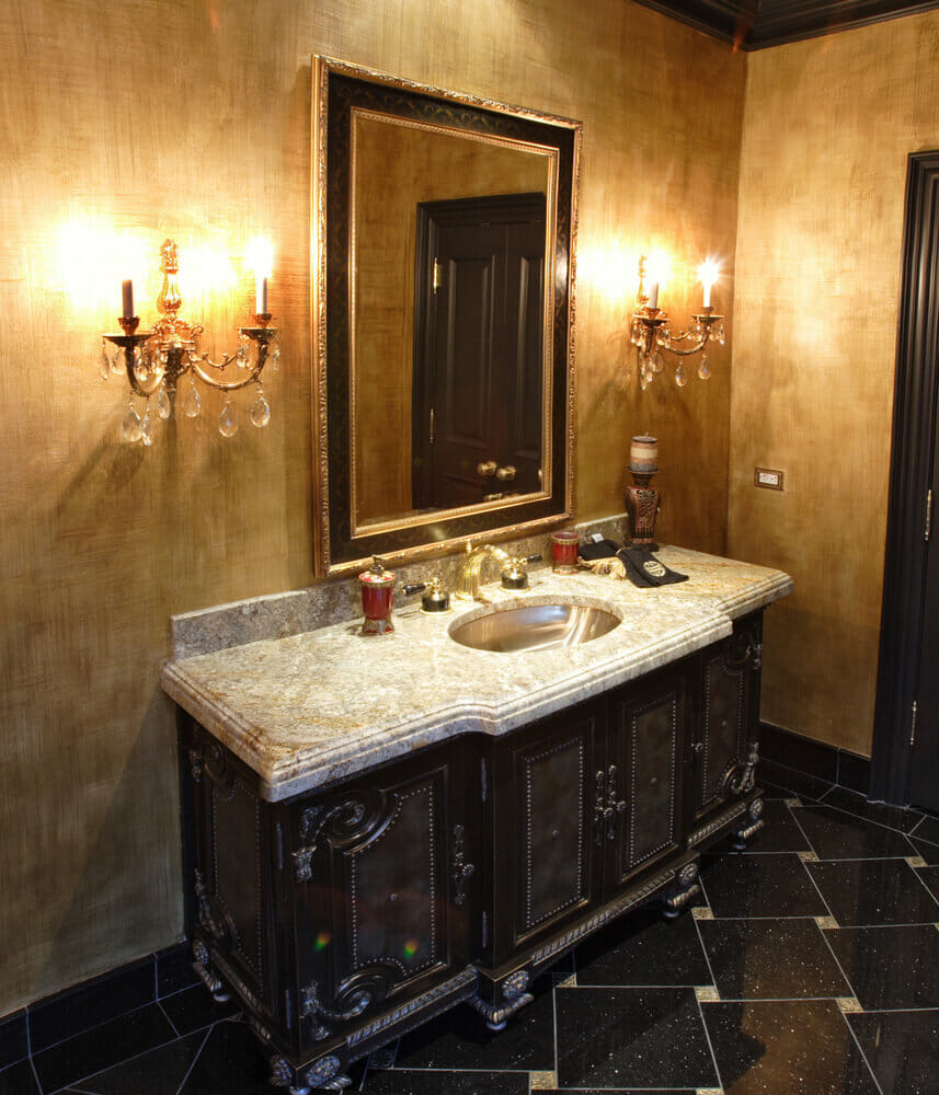 Custom bathroom designs - Rich Warm Tones On The Walls Along With Ornate Decor Gives A True Feeling Of Luxury