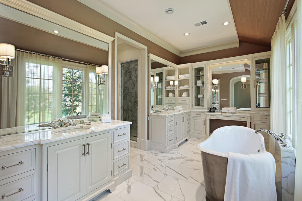 white cabinets with shining marble utilized on floor makes it more bright and clean - Luxury Master Bathroom
