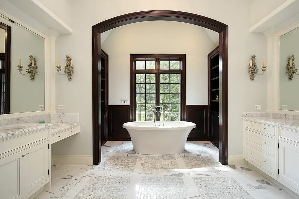 Simple design yet full of details. From the wood trim to the marble flooring this bathroom says luxury.