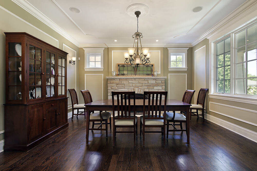 dark floors with a simple six person dining set detailed walls with a