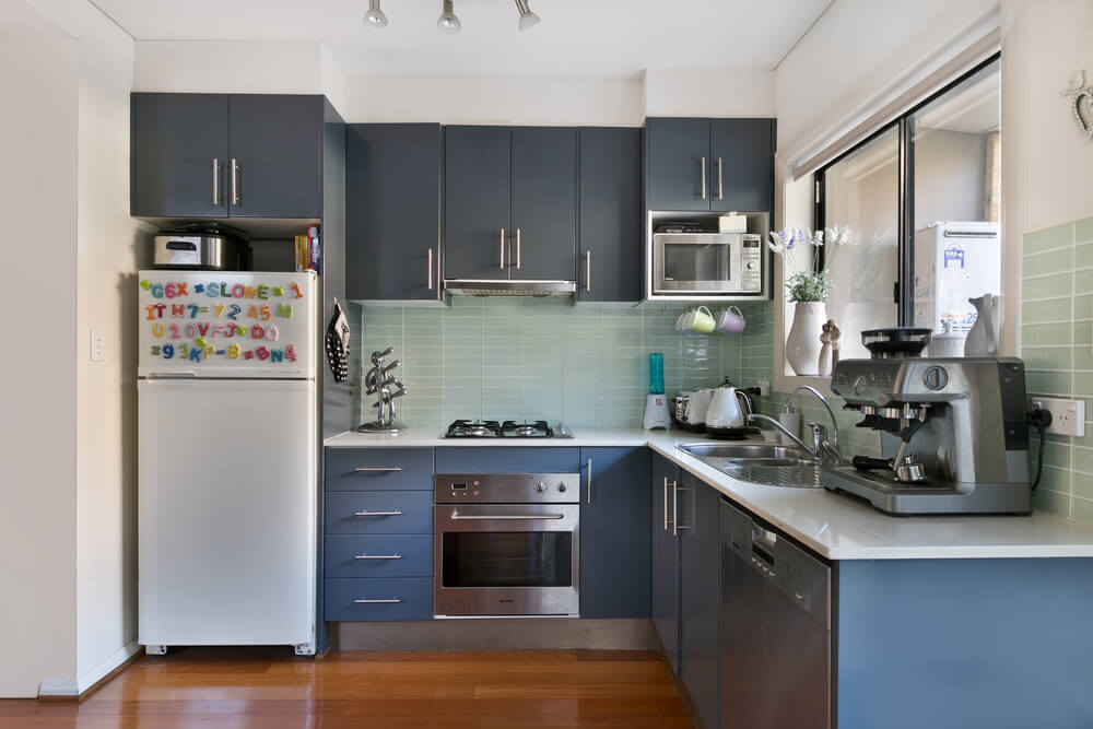 This grey kitchen cabinetry adds a very modern and personalized slant on the traditional dark cabinet trend.