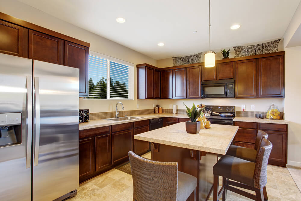 brown wicker chairs in light brown and beige tones bring fun and informal seating to this - Beige Kitchen Cabinets
