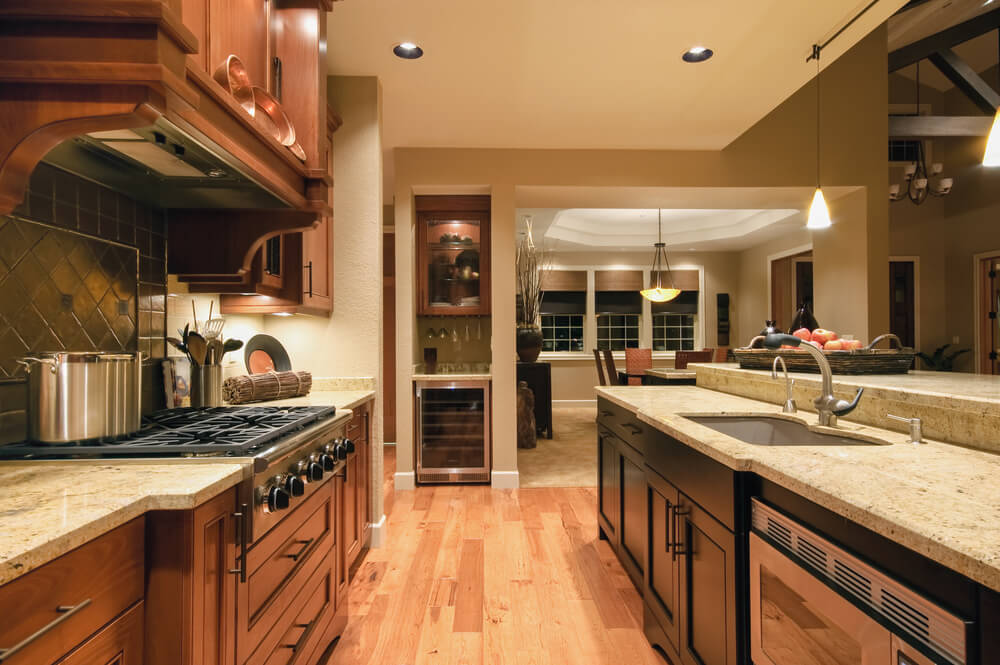 This Homely Kitchen Uses Two Different Styles And Colors Of Dark Wooden  Cabinets. One Is