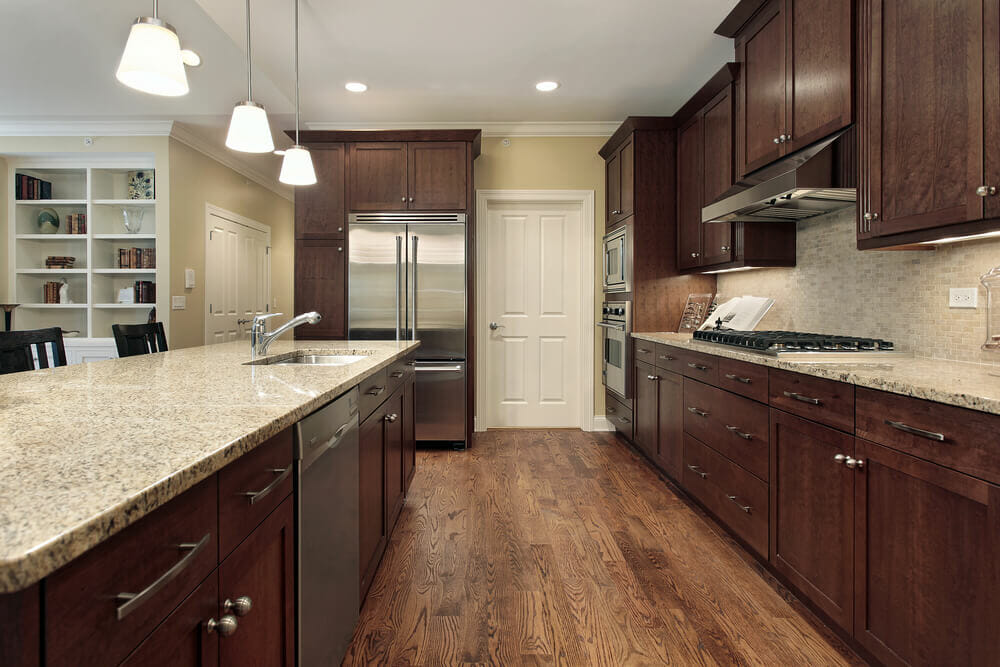 These Wooden Cabinets Are Very Traditional In Color And Style But Silver Appliances And Cabinet