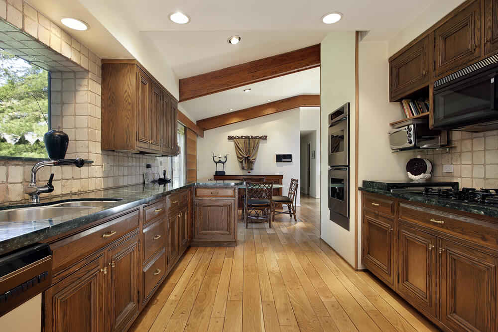 dark cabinets with white granite