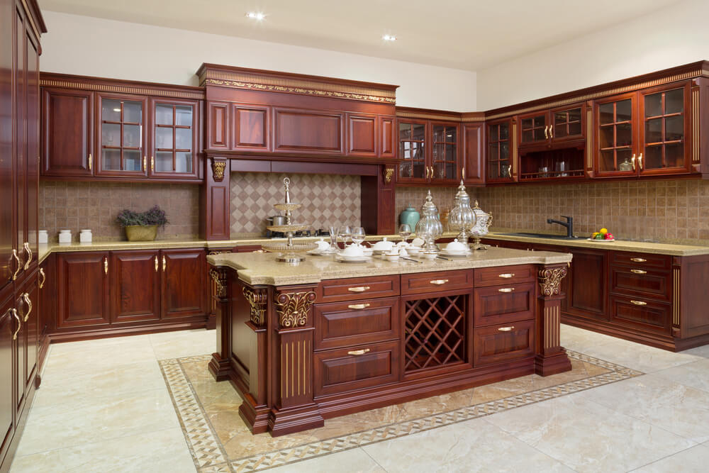 Medium image of accents of gold in the floor and cabinets of this home lighten the dark cabinets and