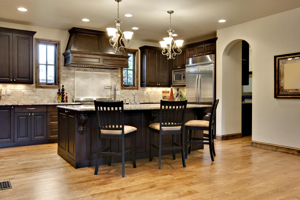 wonderful Dark Kitchen Cabinets Ideas #4: This kitchen uses a spectrum of lighter shade of cream, brown, and beige to