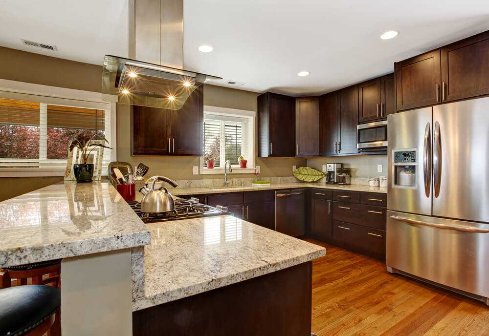 The Mix Of Materials In This Kitchen Including Different Shades Of Wood Granite