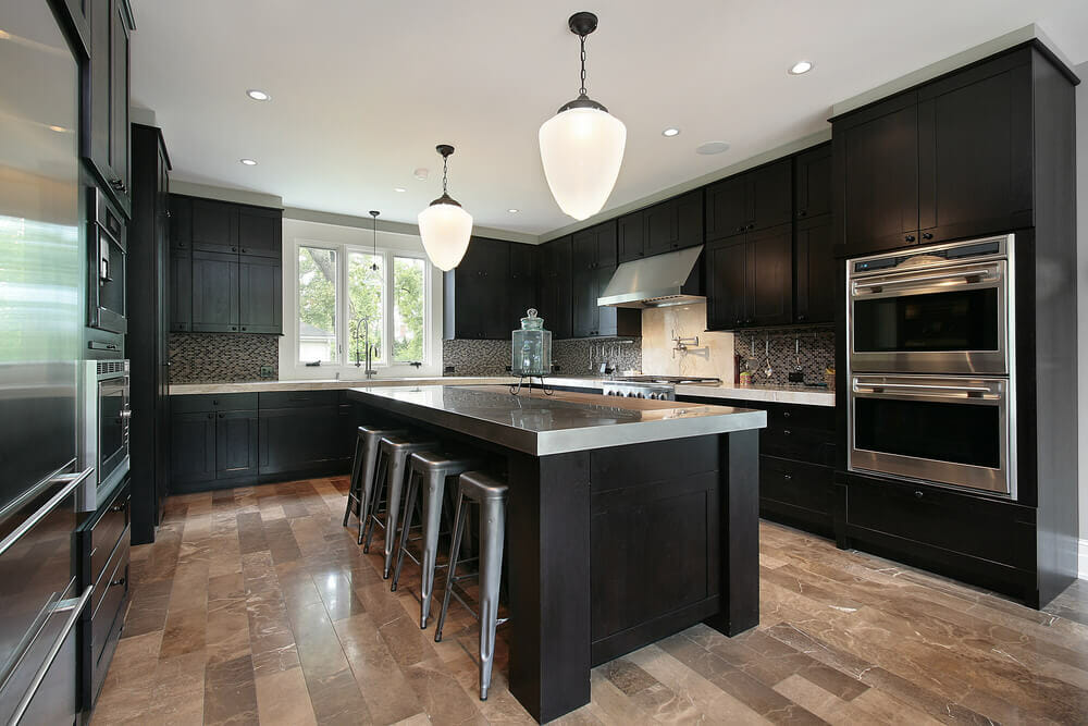 Black Kitchen Cabinets with Stainless steel accents