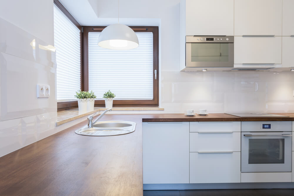 Shutterstock_245906299. The Large Corner Window In This Kitchen ...