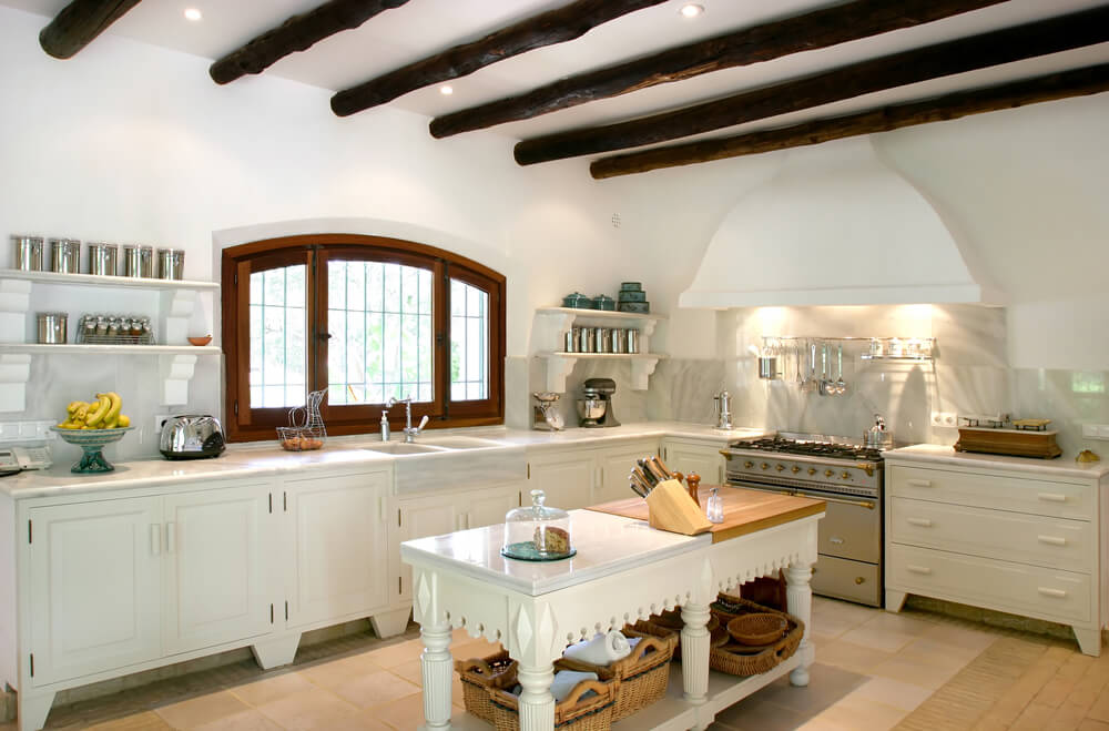 Bright, rustic and modern kitchen interior of large spanish villa. With wooden rafters on the ceiling in a traditional style.