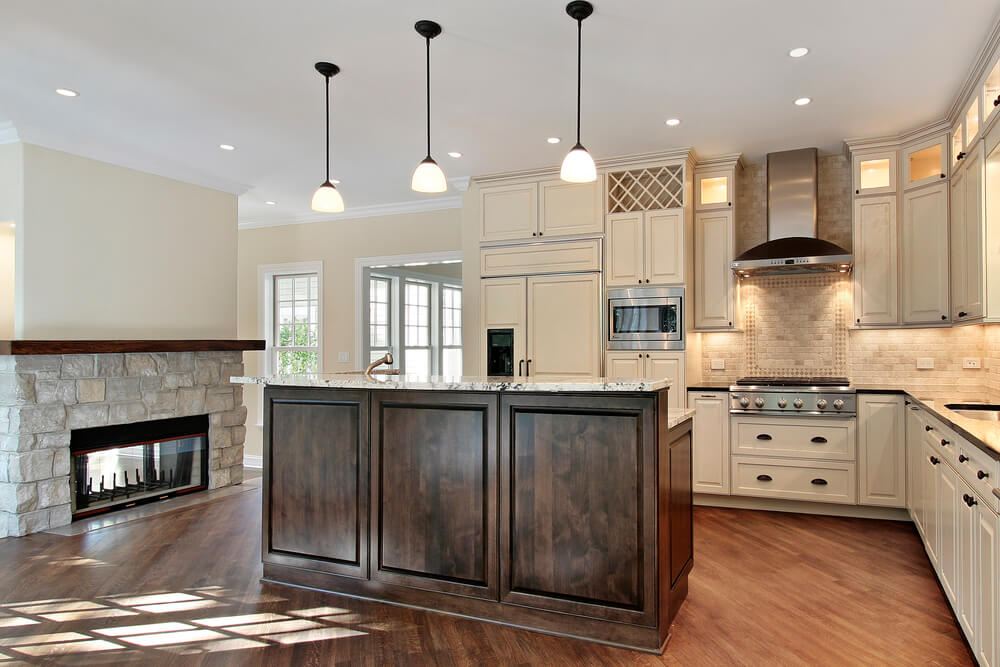 kitchen in new construction home with stone fireplace