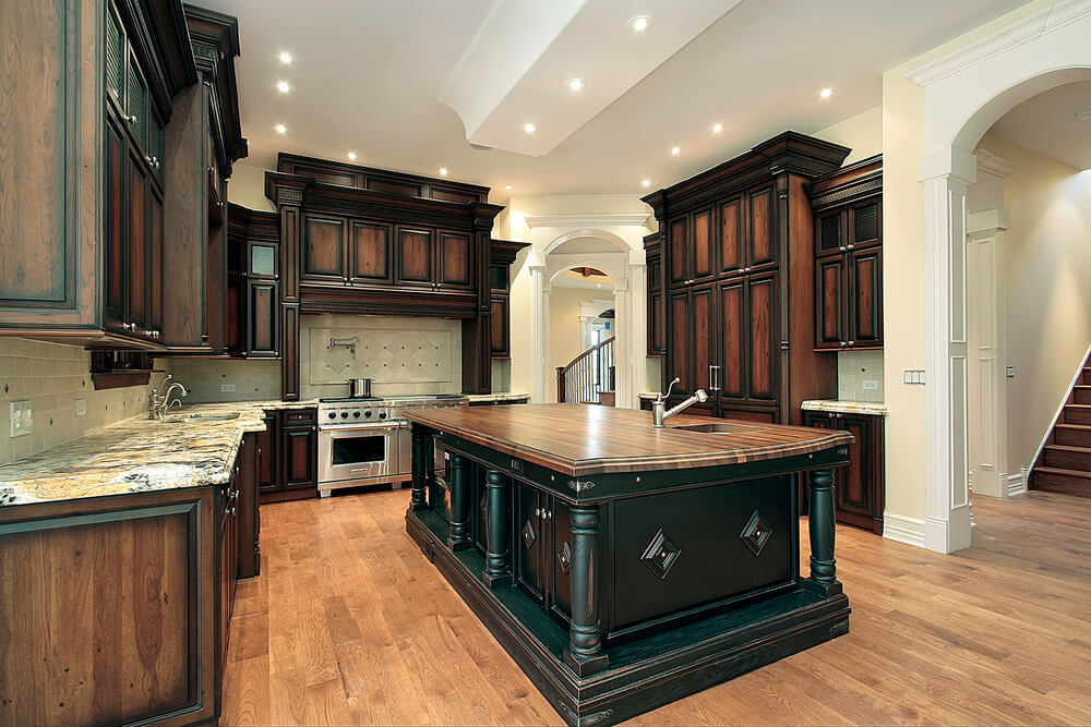 Kitchen in new construction home with dark wood cabinetry