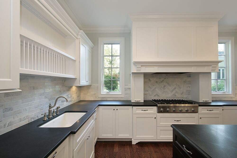 Shutterstock_37067752. This Classic Kitchen Features A Striking Combination  Of Black Counter Tops And White Cabinets.