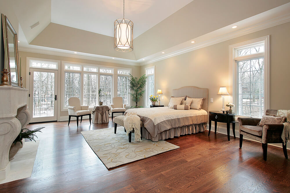 Master bedroom in new construction home with fireplace
