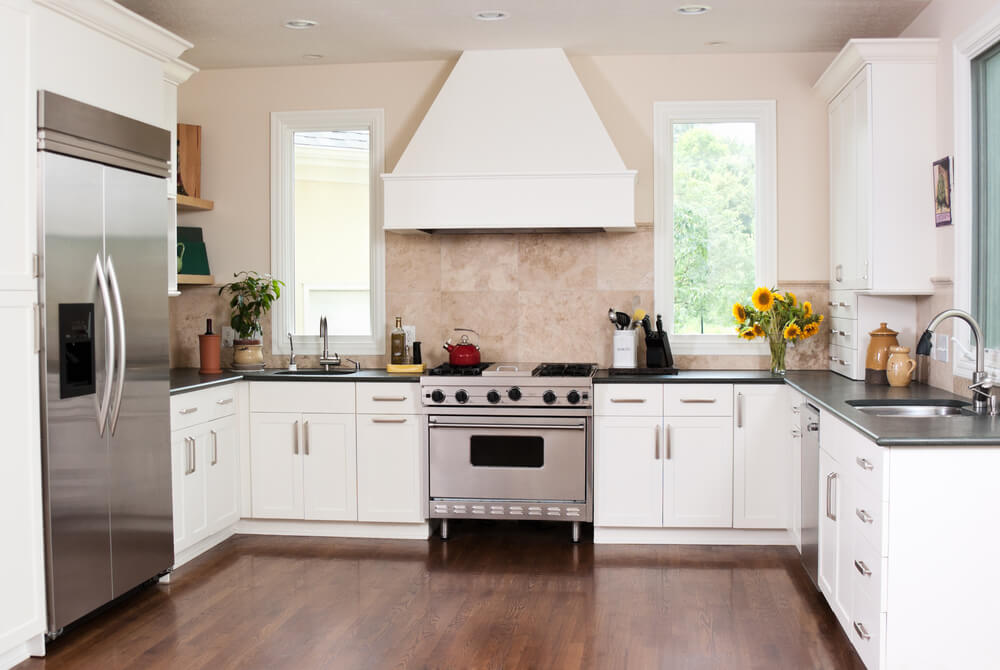 this u shaped kitchen is designed with features such as two sinks as