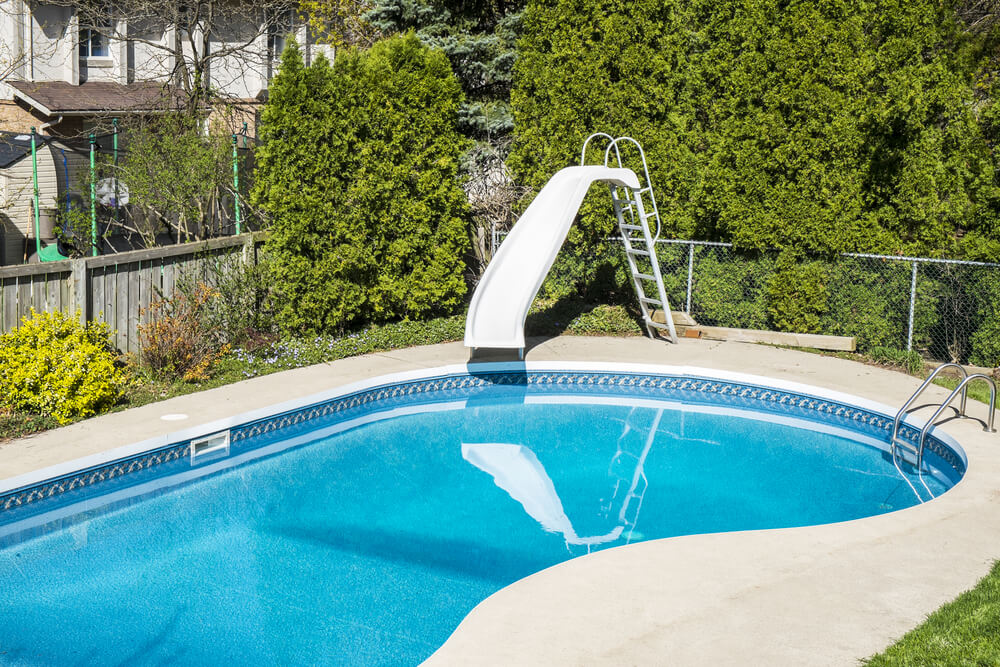 Swimming pool designs in ground pool ideas for Swimming pool slides
