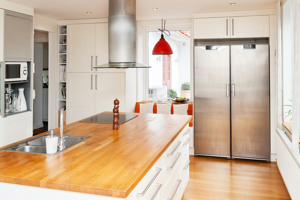 Wood countertops add a new texture to a kitchen and break up the whiteness of the space without sacrificing aesthetic.