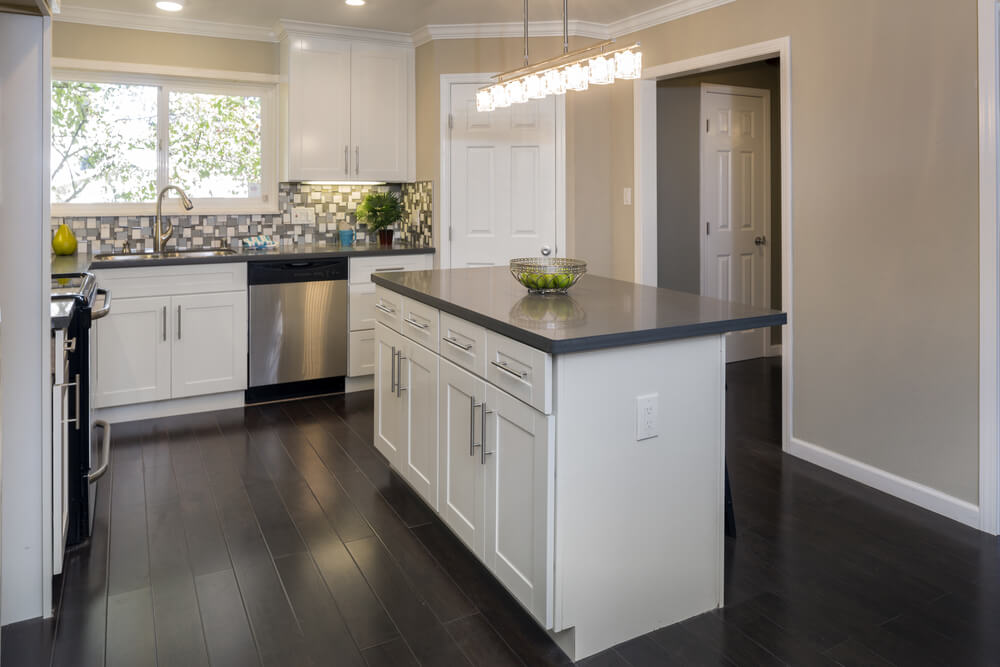 Dark, wood-paneled floors are easy on the feet and don't show as much dirt as a lighter tile floor might.