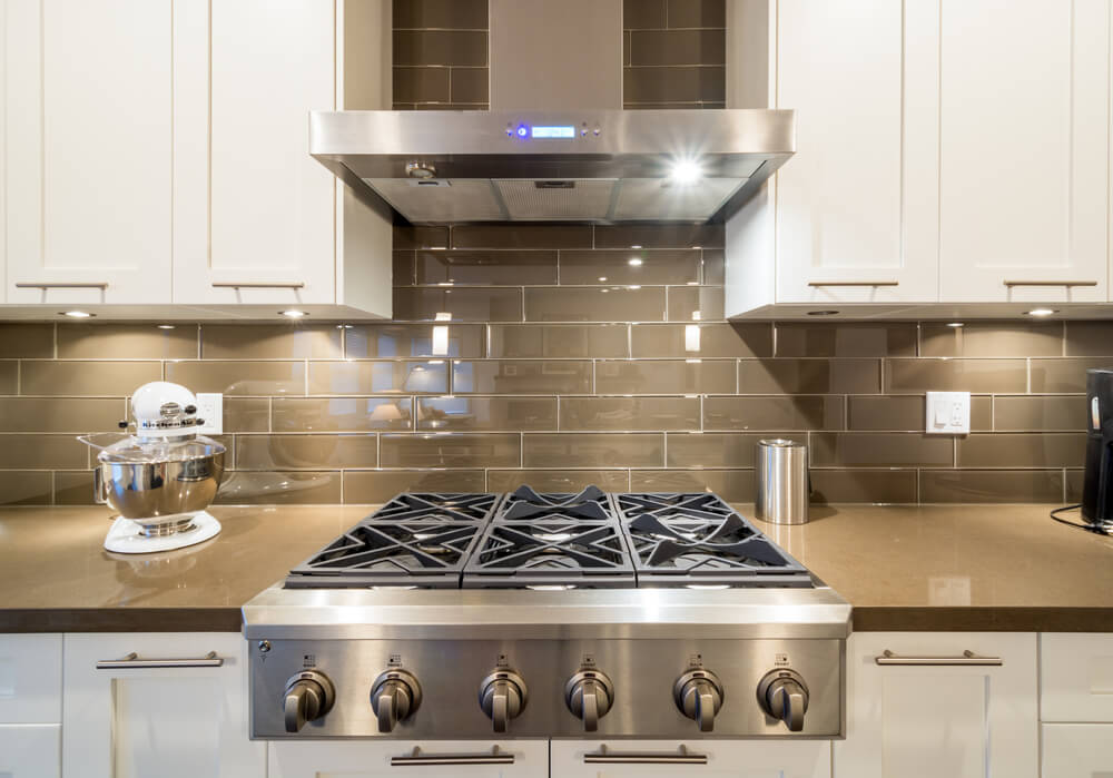 This stainless steel gas stove has enough burners for even the most serious chef.