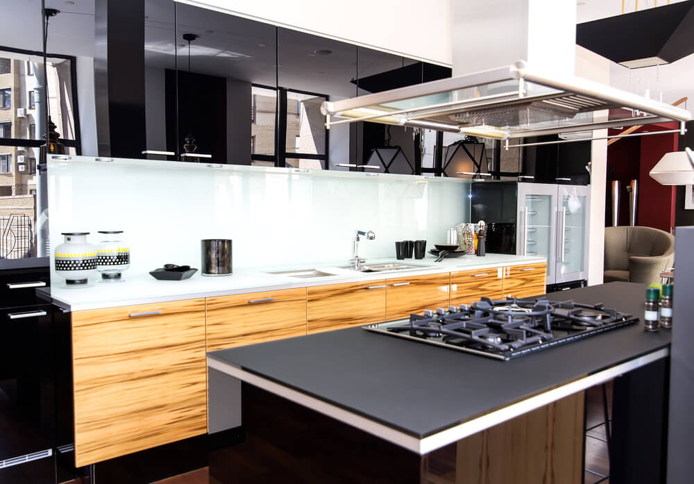 Moving your stovetop to the kitchen island is a smart way to control the flow of activity in your kitchen.