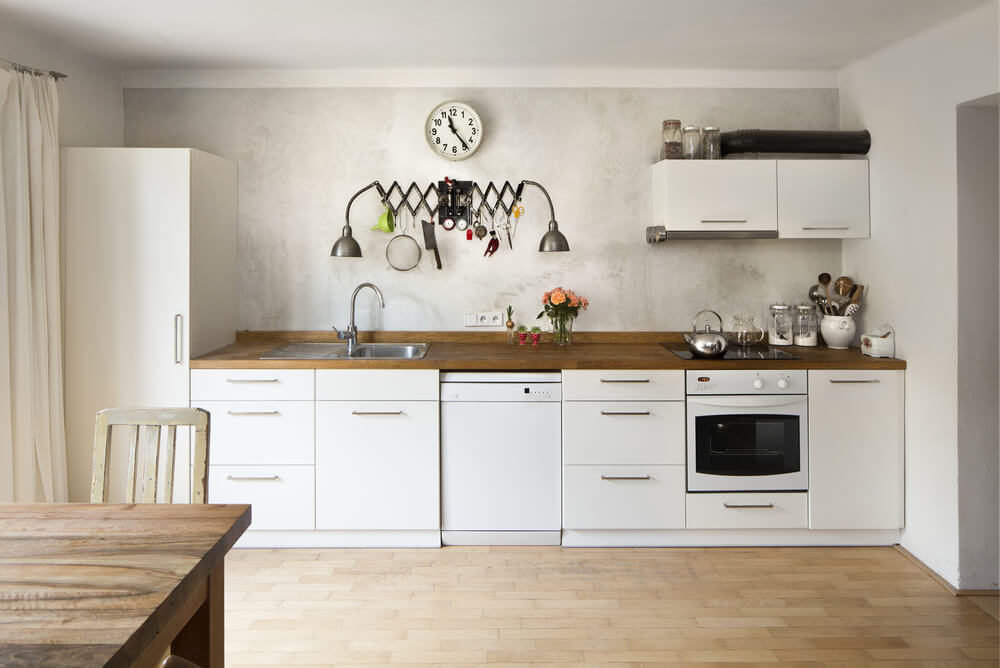 For smaller kitchens, integrate your refrigerator and other appliances with your cabinets.