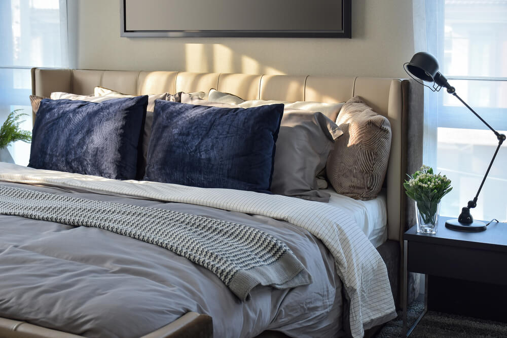Mix and match your pillows for a combination of comfort and chic seasonal bedding.