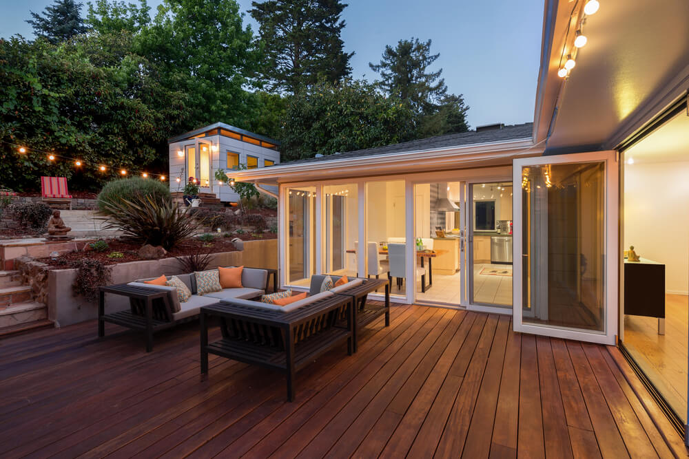 This Deck Combines Modern Bistro Lights And Hardwood For A Classic,  Welcoming Feel.