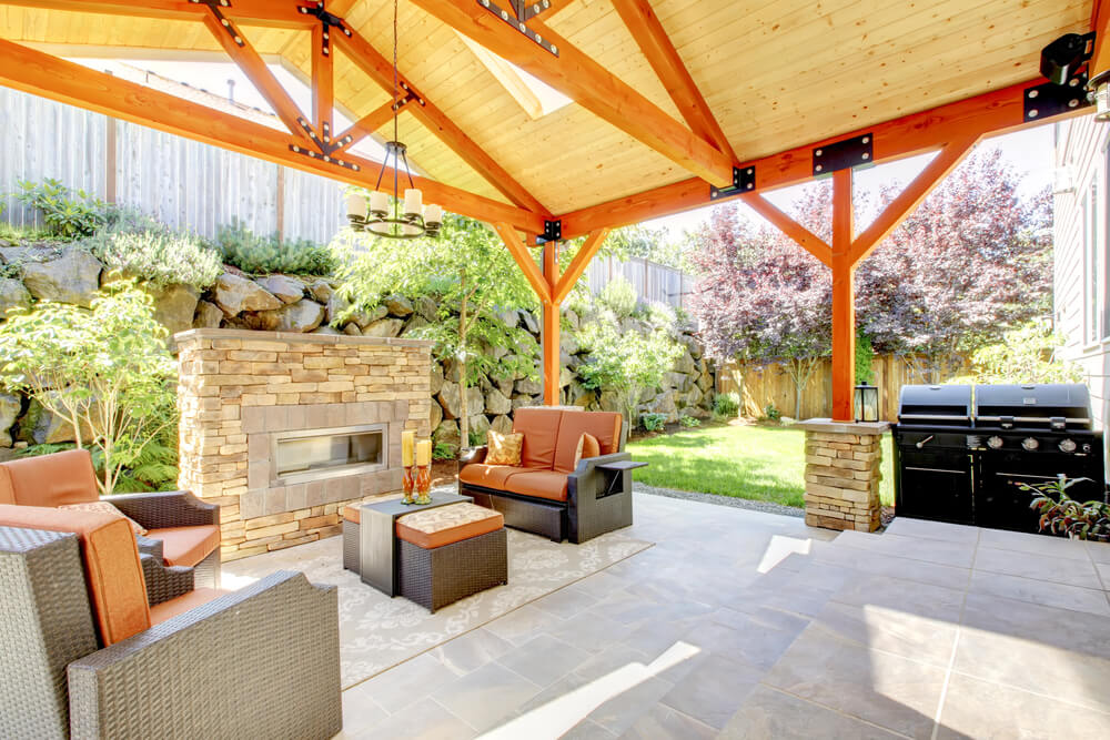 This patio combines the lightness from the color palette with stone for a natural, airy feel.