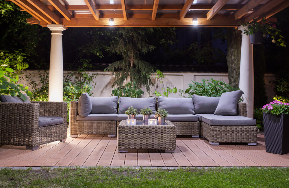 The neutral color palette of this patio makes the green garden come alive.