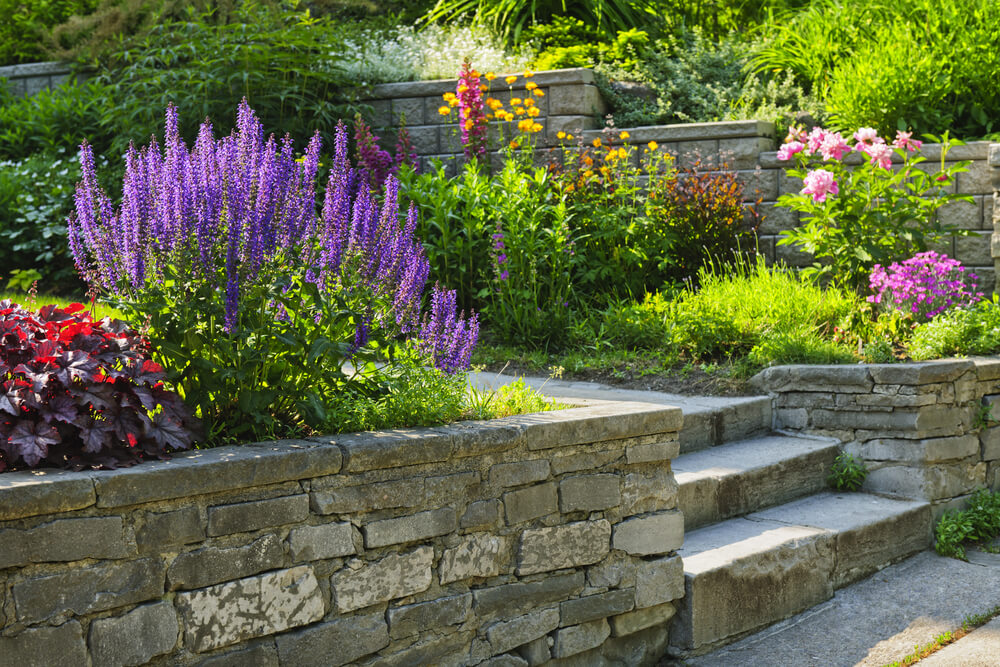 Planning your backyard landscape can take some time, but gardens like this are worth it!