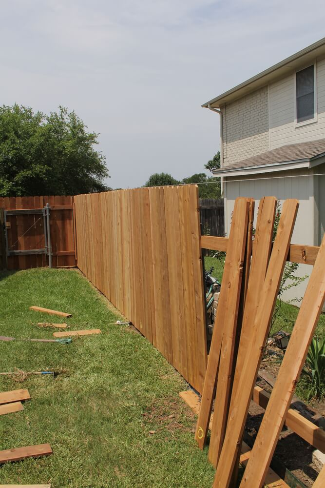 A very common example using standard cedar fence boards. By using these boards, fence repair is reasonably priced and is fairly simple to do.