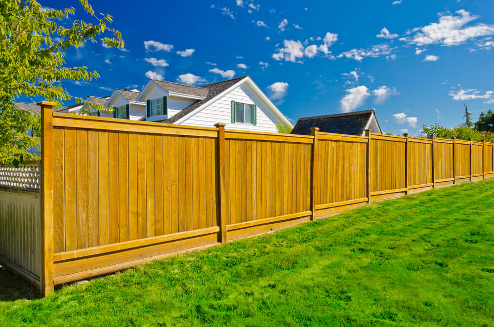 Cedar fence panels with a 4x4 cedar fence post and caps. - 101 Fence Designs, Styles And Ideas (BACKYARD FENCING AND MORE!)