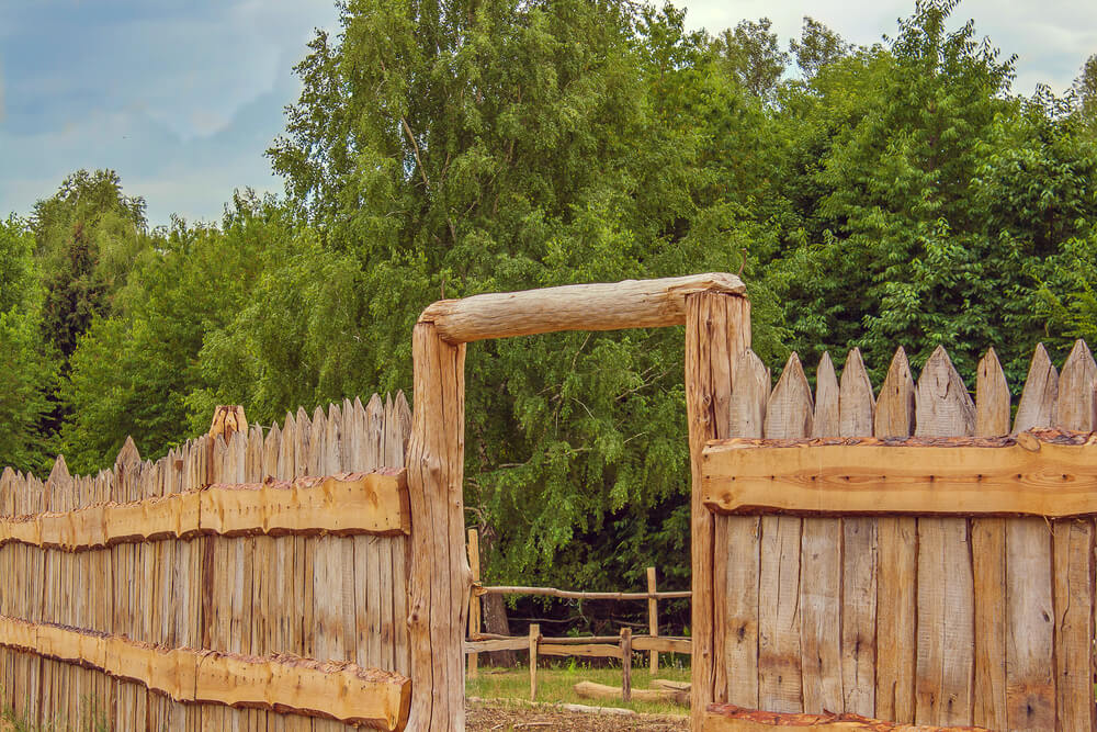 A Rustic Stockade Fence Used In Farm Setting