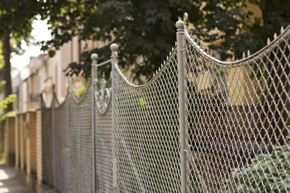 A chain link gate can come in many shapes and sizes.