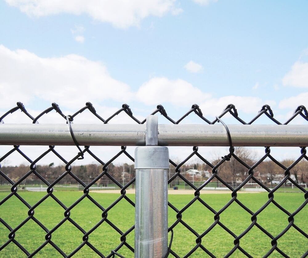 101 fence designs styles and ideas backyard fencing and more black chain link fence is a cheap way to make this industrial fencing look more appealing baanklon Images