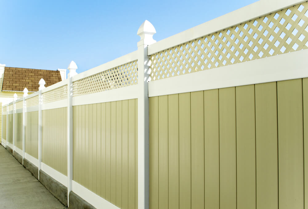 Plastic fence panels are an easy choice due to cost and durability.