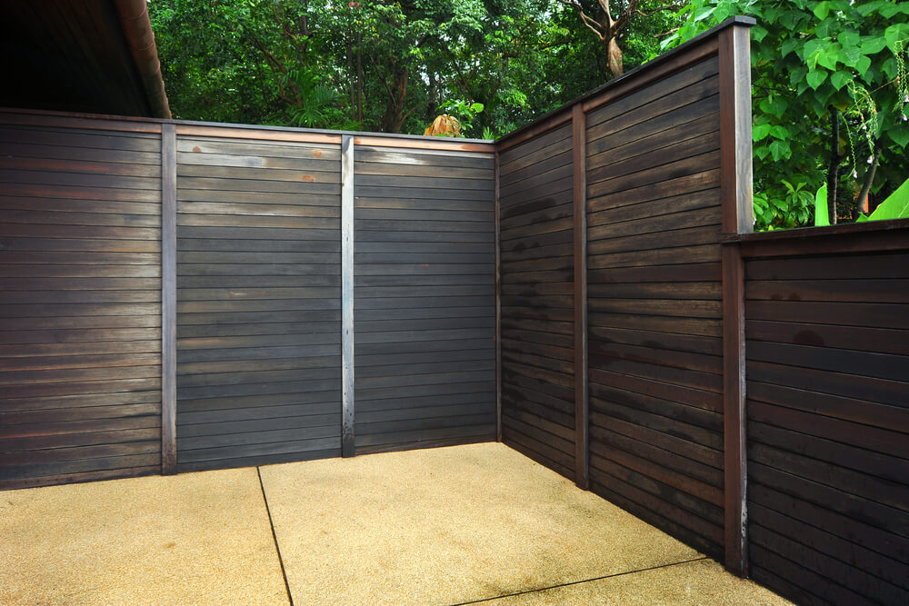 small wood planks fixed horizontally and painted dark - Fence Design Ideas