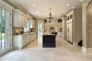 The white granite colors of these tiles is timeless and looks great with the antique white and deep brown cabinets. It's simple enough to blend and be beautiful without pulling the attention away.