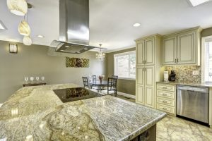 This granite slab is definitely unique with colors of green and grey throughout and it matches not only the floor tiles but the small tiles on the wall as well. Paired with the antique white cabinets, these granite tiles are definitely a sight.