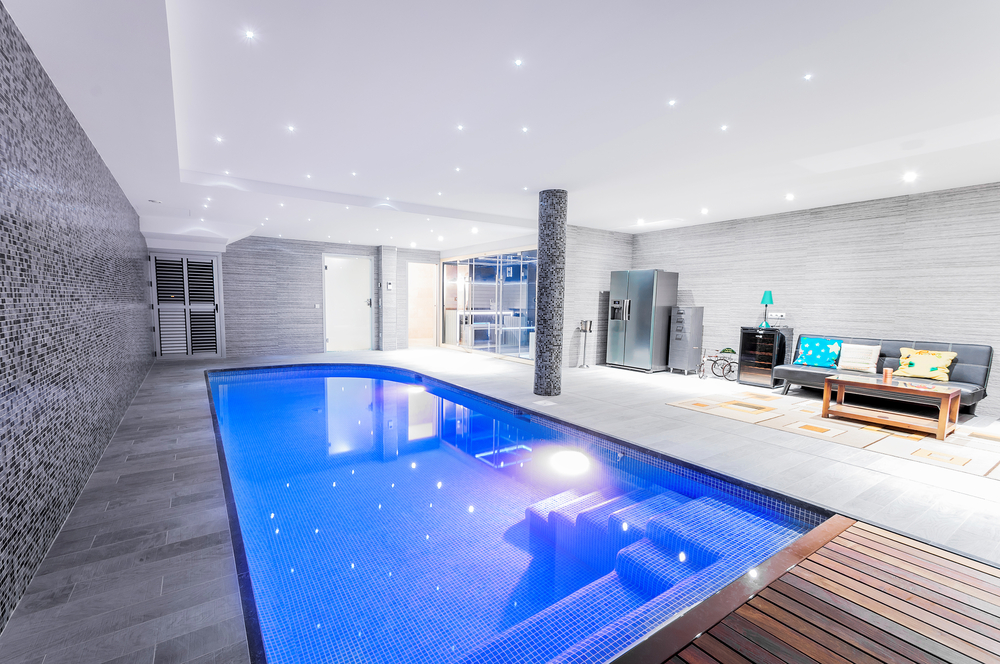 This pool has a little bit of everything with a stamped stone on one side and two different types of wood on the others. It's something you won't see many places, but the mix and match really seems to work.