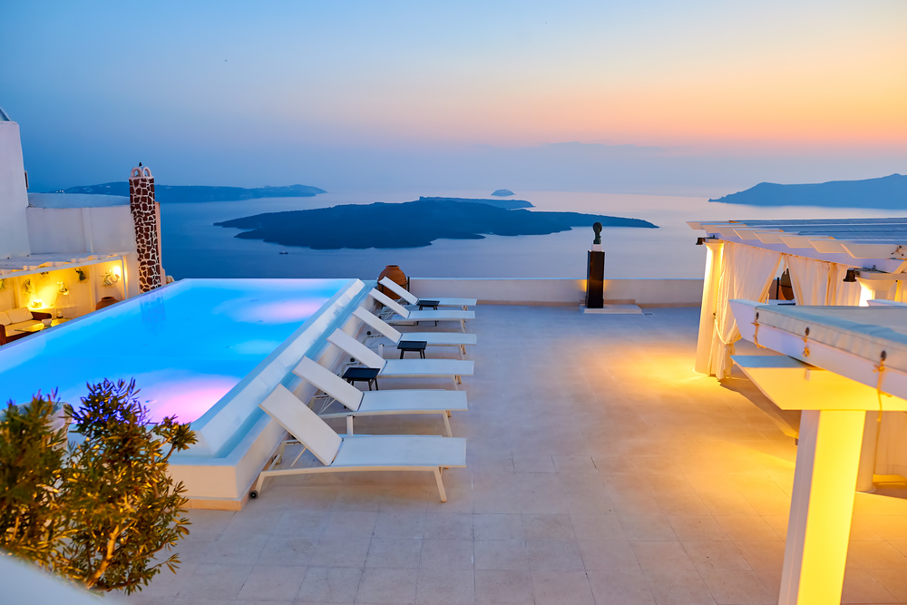 Who says a small pool needs to be boring? This small pool actually has an infinity edge that overlooks the cliffs and that's really going to be a great experience.