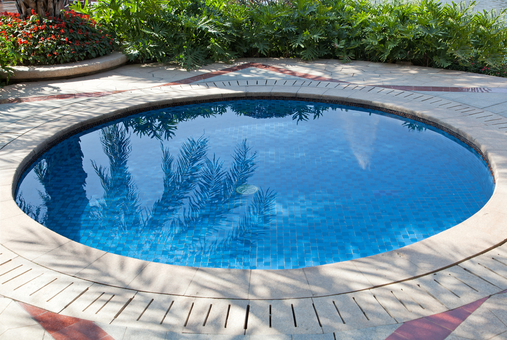 This small circle pool is just the right size for relaxing after a long day. The stylish stone around the outside and the nearly level surface to the edge is just like your own personal spring.