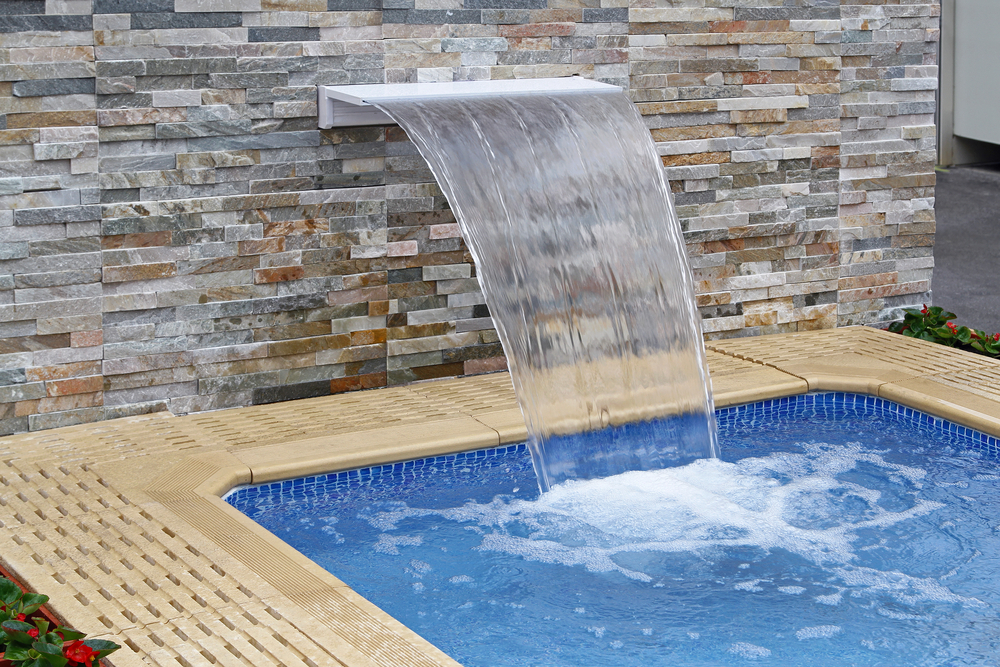 this sheet of water comes right out of the brick wall and creates a larger waterfall - Pool Waterfalls
