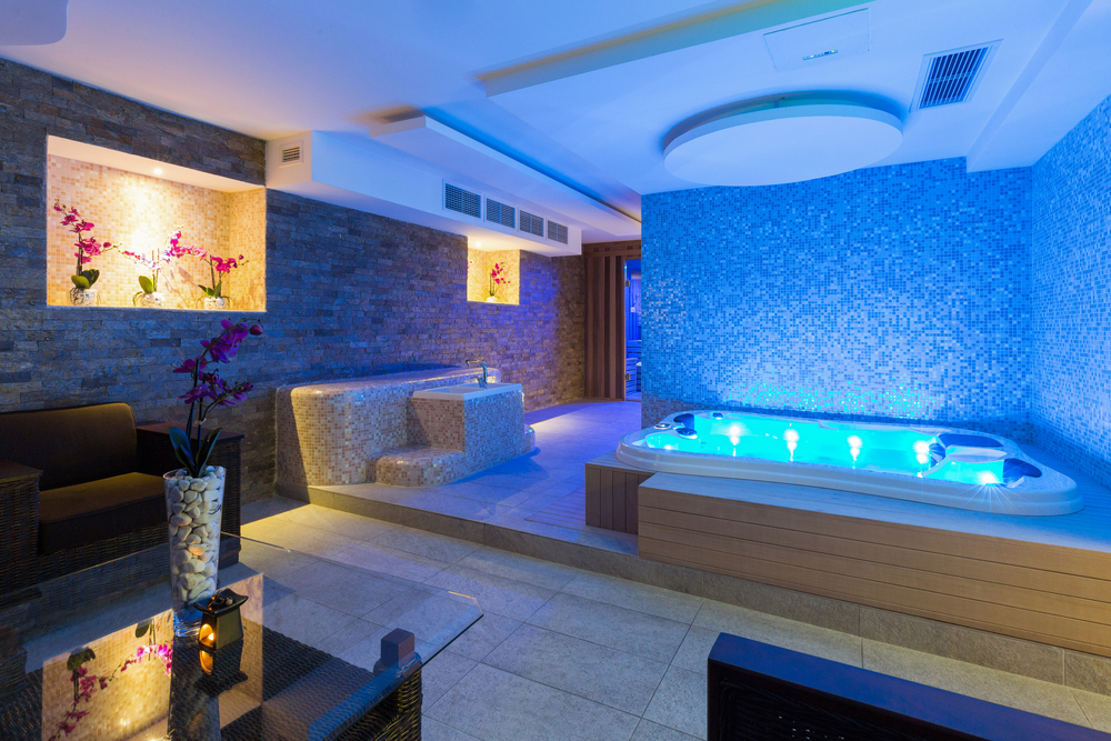 In this room you've got a little bit of darkness to help you relax and the lighted pool makes it even more fun. Plus there's a seating area if you want to get out of the tub and relax even more.