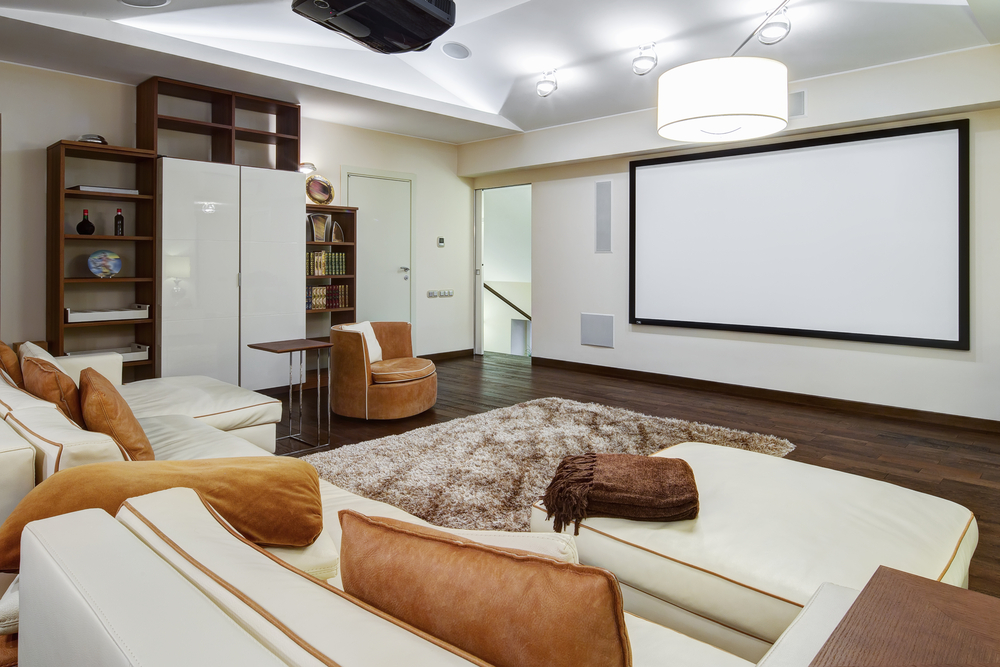 If you want to save a little on a movie room but still get a great accomplishment you will like this room. it has couches to make it more comfortable for relaxing and a large screen but with some space for other things on the sides.