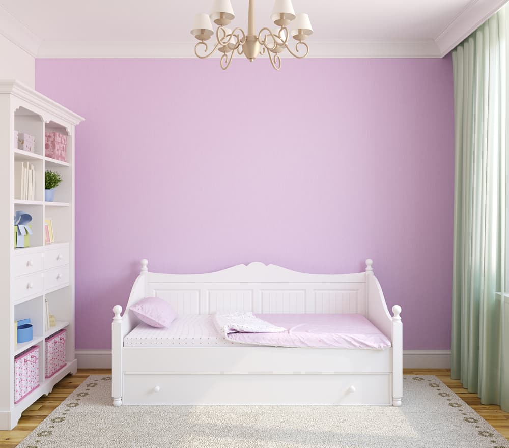A white day bed for a girls room.