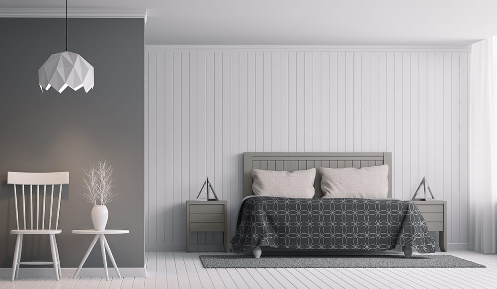 We've got a two-tone walls here, with some pale and some dark. Plus the bed and other furniture and even the blankets and rug emphasize a range of different gray tones to get a great rainbow effect.