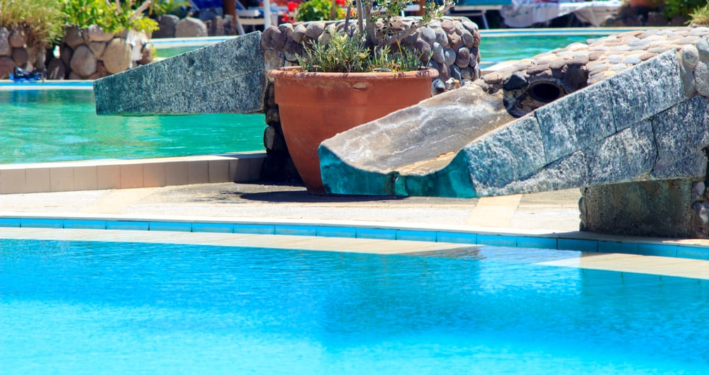 Salt water pool systems saltwater maintenance vs - Can you swim after putting algaecide in pool ...